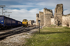 A train approaches ruins at Smederevo Fortress in Serbia - 16856-560