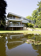 View across lake of balconies at rear of modernist, Bauhaus style house by Hans Scharoun 1930-33, after 2012 renovation, Lusatia, Germany - 40085-1240-1