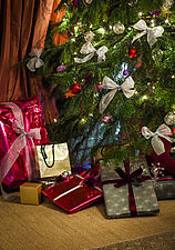 Christmas presents under tree in Chichester home, England, UK - 14877-170-1
