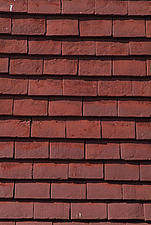 Close up of overlapping red wall hung roof tiles - 10639-110-1