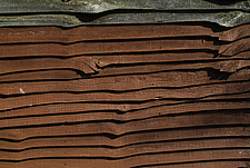 Close up of a stained larch lap fence panel - 10639-120-1