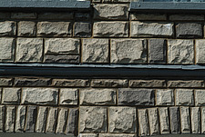 Close up of a grey rough hewn wall - 10639-130-1