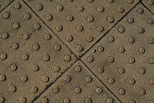 Close up of textured dimpled paving blocks - 10639-140-1