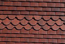 Close up of straight and scalloped red clay roof tiles - 10639-260-1