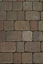 Close up of mottled red paving blocks - 10639-290-1