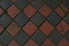 Close up of diamond shaped black and red path tiles - 10639-30-1