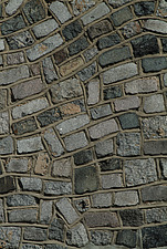 Close up of grey paving blocks set in a random wave pattern - 10639-300-1