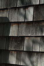 Close up of overlapping wall-hung timber tiles - 10639-440-1