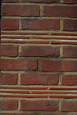 Detail of red clay brick tile and mortar wall stretcher bond with tile course - 10639-540-1