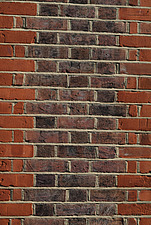 Close up of a red and black brick wall - 10639-60-1