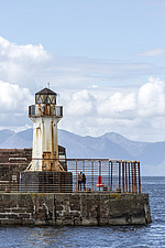 Ardrossan Harbour Lighthouse with Isle of Arran in background, Ayrshire, Scotland - 16938-40