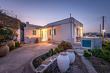 Exterior view at dusk of vernacular house renovation in Sifnos island Greece by Katerina Komi - 16942-210