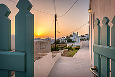 Exterior entrance view at sunrise of vernacular house renovation in Sifnos island Greece by Katerina Komi - 16942-230