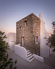 Exterior view of north-west corner at sunset, holiday house in Paros Island Greece by Nikolas Kouretas - ARC100430