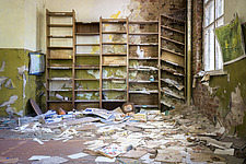 An abandoned school in Chernobyl with books on the floor - ARC101590