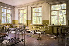 a room with bed frames in an abandoned school in Chernobyl - ARC101591