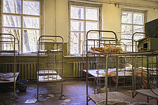 a room with bed frames in an abandoned school in Chernobyl - ARC101592
