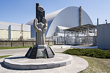 This is a photo in front of the Sarcophagus in Chernobyl - ARC101594