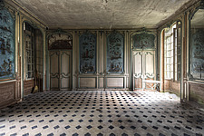 a room with blue wallpaper in an abandoned castle in France - ARC101307