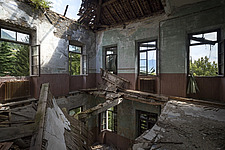 a room with a hole in the floor in an abandoned school in Italy - ARC101481