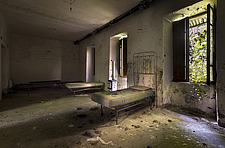 a couple of beds in a room in an abandoned building - ARC101506