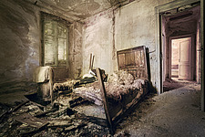 a bedroom in an abandoned hotel in Italy - ARC101517