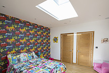 A bedroom in Ashbrook House, a contemporary family eco-house in Blewbury, South Oxfordshire, UK - ARC102995