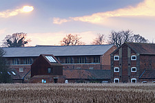 Exterior of Iken View, renovated maltings buildings, Snape Maltings, Snape, Suffolk, UK - ARC103444