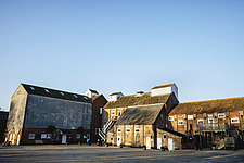 Exterior of Snape Maltings Food Hall ##38; Shops, renovated malting buildings, Snape Maltings, Snape, Suffolk, UK - ARC103447