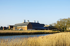 Exterior of Snape Maltings Concert Hall ##38; Concert Hall Cafe, renovated malting buildings, Snape Maltings, Snape, Suffolk, UK - ARC103448