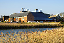 Exterior of Snape Maltings Concert Hall ##38; Concert Hall Cafe, renovated malting buildings, Snape Maltings, Snape, Suffolk, UK - ARC103449