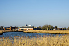 Exterior of Snape Maltings Concert Hall ##38; Concert Hall Cafe, renovated malting buildings, with reedbeds ##38; River Alde Snape Maltings, Snape, Su... - ARC103450