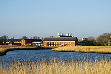 Exterior of Snape Maltings Concert Hall ##38; Concert Hall Cafe, renovated malting buildings, with reedbeds ##38; River Alde Snape Maltings, Snape, Su... - ARC103451