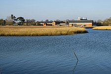Exterior of Snape Maltings Concert Hall ##38; Concert Hall Cafe, renovated malting buildings, with reedbeds ##38; River Alde Snape Maltings, Snape, Su... - ARC103452