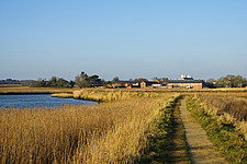 Exterior of Snape Maltings Concert Hall ##38; Concert Hall Cafe, renovated malting buildings, with reedbeds ##38; River Alde Snape Maltings, Snape, Su... - ARC103453