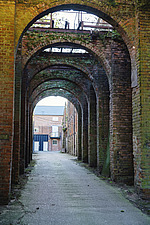 Archways at Snape Maltings, renovated Victorian malting buildings, Snape Maltings, Snape, Suffolk, UK - ARC103462