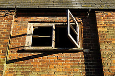 Old, Broken Window, renovated Victorian malting buildings, Snape Maltings, Snape, Suffolk, UK - ARC103464