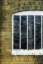 Old arch topped window, exterior of malting buildings, renovated Victorian malting buildings, Snape Maltings, Snape, Suffolk, UK - ARC103467