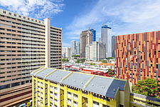 HDB public housing block in Bugis area in  Singapore, with Duo Tower still in construction at the background - ARC103879