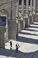 Visitors photograph the exhibition road entrance at the V&A, London, UK, completed in 2017 - ARC104235