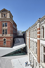 Two men walk through the new extension of the Sackler Courtyard, V&A, London, UK, completed in 2017 - ARC104236