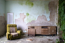 Room with a chair and plants on the wall in an abandoned hospital in Germany - ARC104507
