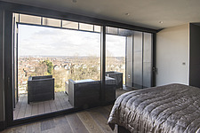 Master bedroom with panoramic view towerds East London of a refurbished top floor flat of a large detached Victorian property and attic conversion inc... - ARC105679