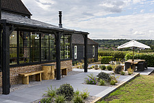 Patio and garden in a converted barn/mill in Essex, UK, featuring beautful steel windows - ARC105864