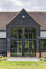 Exterior view of a converted barn/mill in Essex, UK, featuring beautful steel windows - ARC105865