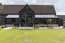Exterior view of a converted barn/mill in Essex, UK, featuring beautful steel windows - ARC105866
