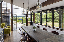 Kitchen and dining area in a converted barn/mill in Essex, UK, featuring beautful steel windows - ARC105869