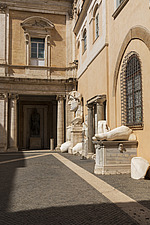 Fragments of the 4th century AD colossal statue of Constantine the Great in the courtyard of the Palazzo dei Conservatori, Capitoline Museums, Rome, I... - ARC106971